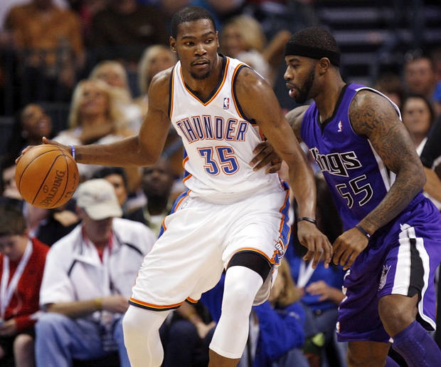 Oklahoma City's Kevin Durant (35) works the ball against Sacramento's Terrence Williams (55) during the NBA basketball game between the Oklahoma City Thunder and the Sacramento Kings at Chesapeake Energy Arena in Oklahoma City, Friday, April 13, 2012. Oklahoma City won, 115-89. Photo by Nate Billings, The Oklahoman