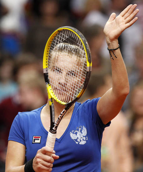 Russia's Svetlana Kuznetsova celebrates victory over Serbia's Ana Ivanovic during their the Fed Cup semifinal match in Moscow, Russia, Saturday, April 21, 2012. (AP Photo/Misha Japaridze) ORG XMIT: XMJ123