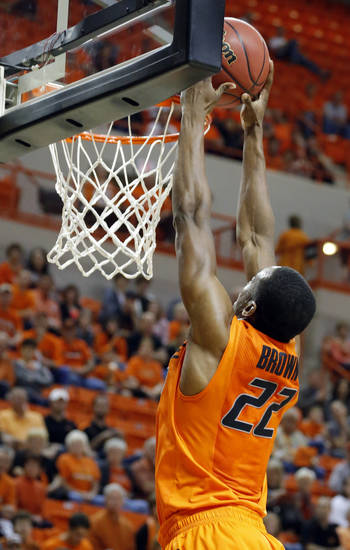 Oklahoma State's Markel Brown (22) dunks 3during the men's college basketball game between Oklahoma State and UC Davis at  Gallagher-Iba Arena in Stillwater, Okla., Friday, Nov. 9, 2012. Photo by Sarah Phipps, The Oklahoman