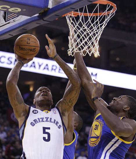 Memphis Grizzlies' Marreese Speights (5) shoots against Golden State Warriors' Festus Ezeli (31) during the first half of an NBA basketball game Friday, Nov. 2, 2012, in Oakland, Calif. (AP Photo/Ben Margot)