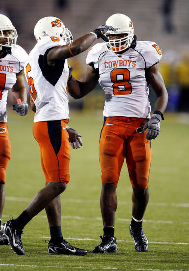 Ricky Price (6) congratulates Donovan Woods (8) on a stop during the second half of the  college football game between Oklahoma State University and Baylor University at Floyd Casey Stadium in Waco, Texas, Saturday, Nov. 17, 2007. BY STEVE SISNEY, THE OKLAHOMAN
