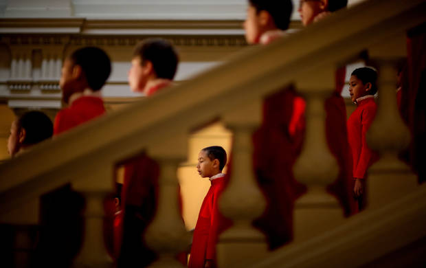 Micah Foster, 10, with the Atlanta Boys Choir, performs on the steps inside the State Capitol during a ceremony celebrating the Rev. Martin Luther King Jr., Thursday, Jan. 17, 2013, in Atlanta. (AP Photo/David Goldman)