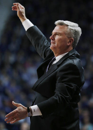 Kansas State coach Bruce Weber gestures to his team during the first half of an NCAA college basketball game against Iowa State in Manhattan, Kan., Saturday, Feb. 9, 2013. (AP Photo/Orlin Wagner)