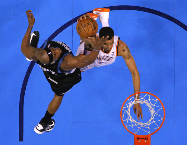 Oklahoma City's Thabo Sefolosha (2) goes to the basket beside Minnesota's Dante Cunningham (33) during an NBA basketball game between the Oklahoma City Thunder and the Minnesota Timberwolves at Chesapeake Energy Arena in Oklahoma City, Wednesday, Jan. 9, 2013.  Oklahoma City won 106-84. Photo by Bryan Terry, The Oklahoman