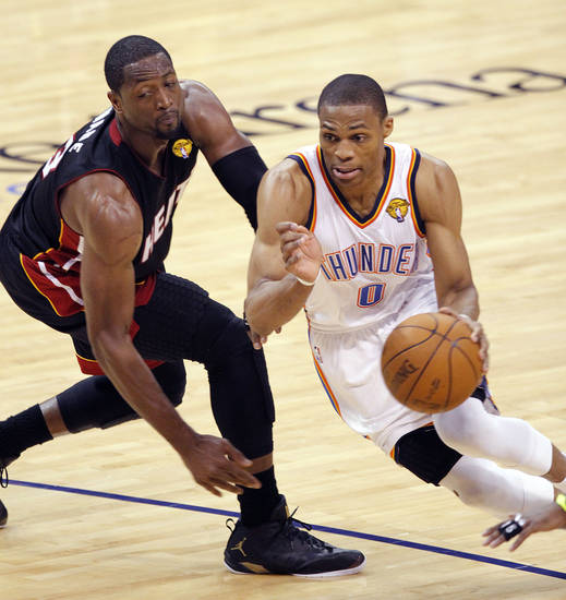 Oklahoma City's Russell Westbrook (0) drives past Miami's Dwyane Wade (3) during Game 2 of the NBA Finals between the Oklahoma City Thunder and the Miami Heat at Chesapeake Energy Arena in Oklahoma City, Thursday, June 14, 2012. Photo by Chris Landsberger, The Oklahoman