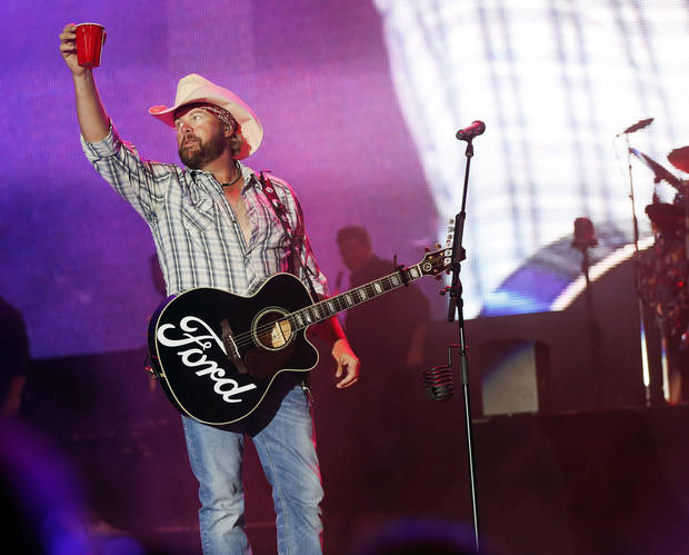 Toby Keith raises his red solo cup as he takes the stage during the Oklahoma Twister Relief Concert, benefiting victims of the May tornadoes, at Gaylord Family - Oklahoma Memorial Stadium on the campus of the University of Oklahoma in Norman, Okla., Saturday, July 6, 2013. Photo by Nate Billings, The Oklahoman
