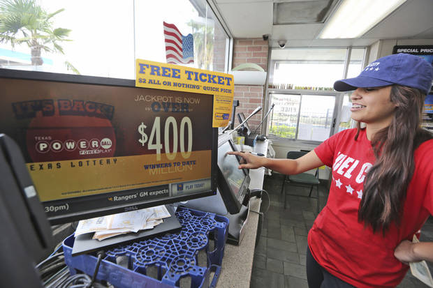 Karen Morales prints out a Powerball lottery ticket for sale to a customer at the Fuel City in Dallas on Wednesday, Sept. 18, 2013. For Wednesday's drawing, Powerball's estimated $400 million jackpot will be the nation's fifth-largest ever. (AP Photo/LM Otero)