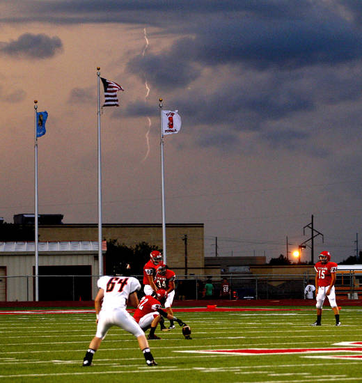 Lightning strikes before a Carl Albert kickoff during a high school football game between Carl Albert and Coweta at Carl Albert in Midwest City, Friday, September 7, 2012. Photo by Bryan Terry, The Oklahoman