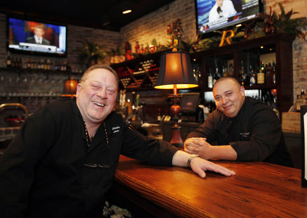 Rococo owner Bruce Rinehart (left) and Chef and Managing Partner Jason Bustamante sit at the bar at Rococo's new location in Northpark Mall. Photo By Paul Hellstern, The Oklahoman
