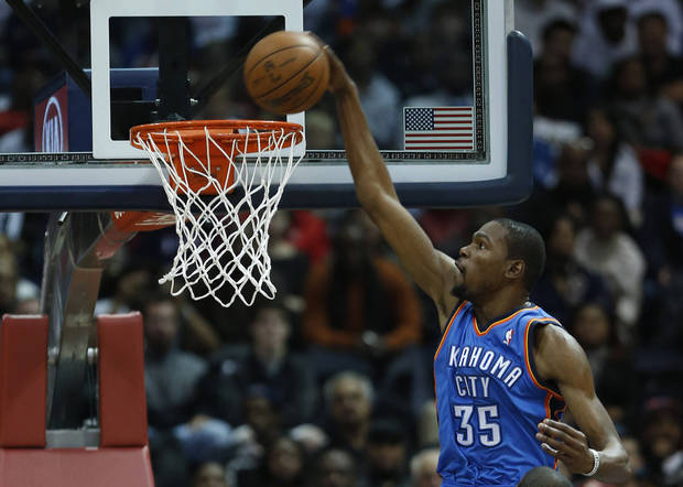 Oklahoma City Thunder small forward Kevin Durant (35)  scores in the first half of an NBA basketball game against the Atlanta Hawks, Wednesday, Dec. 19, 2012, in Atlanta. (AP Photo/John Bazemore)  ORG XMIT: GAJB105