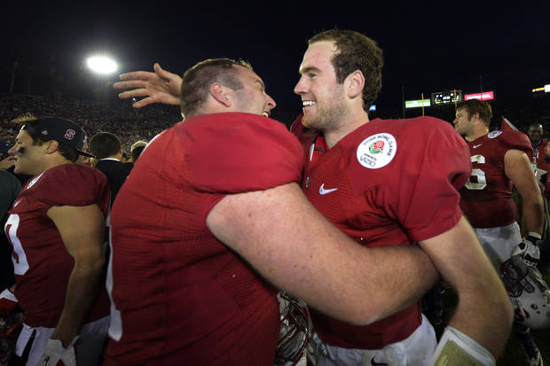 Stanford quarterback Kevin Hogan, right, and guard Conor McFadden celebrate following their 20-14 win over Wisconsin in the Rose Bowl NCAA college football game, Tuesday, Jan. 1, 2013, in Pasadena, Calif. (AP Photo/Mark J. Terrill)