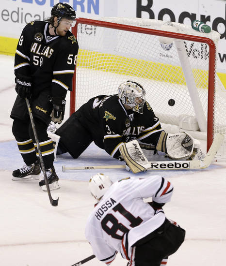 Chicago Blackhawks' Marian Hossa (81), of Slovakia, scores against Dallas Stars goalie Kari Lehtonen (32), of Finland, in overtime as Jordie Benn (58) watches during an NHL hockey game, Thursday, Jan. 24, 2013, in Dallas. The Blackhawks won 3-2. (AP Photo/Tony Gutierrez)