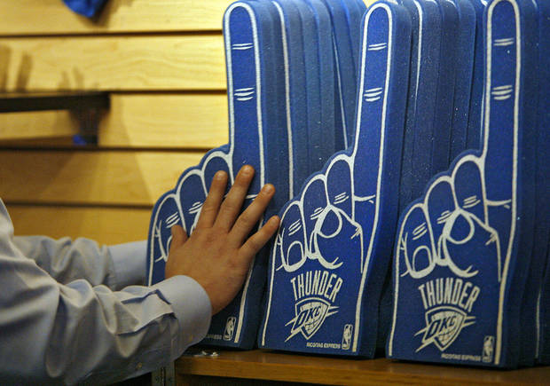 A merchandiser stocks the shelves with Thunder gear before the opening night NBA basketball game between the Oklahoma City Thunder and the Milwaukee Bucks on Wednesday, Oct. 29, 2008, at the Ford Center in Oklahoma City, Okla.