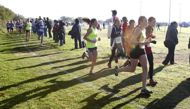 Runners pass the half-way point during the Girls 4A State Cross Country Finals at Edmond Santa Fe High School in Edmond, OK, Saturday, October 27, 2012,  By Paul Hellstern, The Oklahoman
