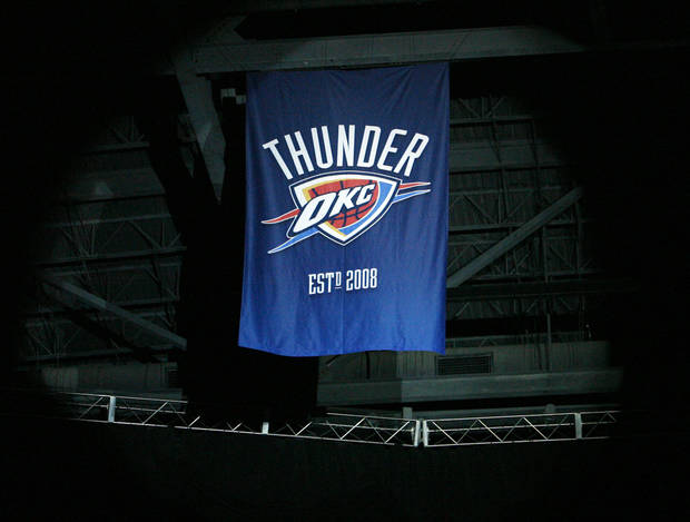 The Thunder banner hangs from the ceiling before the NBA basketball game between the Oklahoma City Thunder and the Milwaukee Bucks at the Ford Center in Oklahoma City, Wednesday, Oct. 29, 2008. This was the regular season debut of the Thunder. BY NATE BILLINGS, THE OKLAHOMAN