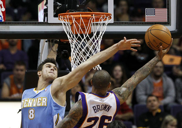 Phoenix Suns' Shannon Brown (26) drives around Denver Nuggets' Danilo Gallinari (8), of Italy, to score in the first half during an NBA basketball game Monday, Nov. 12, 2012, in Phoenix. (AP Photo/Ross D. Franklin)