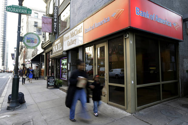 In this Wednesday, Dec. 19, 2012 photo, people walk past a Bank of America branch in Philadelphia. U.S. banks are closing the year with the strongest profits since 2006 and fewer failures than at any time since the financial crisis struck in 2008. They're helping support an economy slowed by high unemployment, flat pay, sluggish manufacturing and anxious consumers. (AP Photo/Matt Rourke)