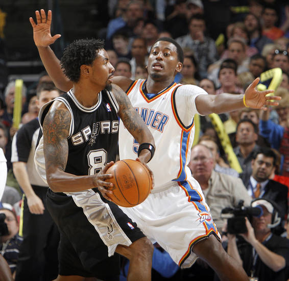 The Thunder's Kyle Weaver (5) defends on the Spurs' Roger Mason (8) during the second half of the NBA basketball game between the Oklahoma City Thunder and the San Antonio Spurs at the Ford Center on Monday, March 22, 2010, in Oklahoma City, Okla.  Photo by Chris Landsberger, The Oklahoman