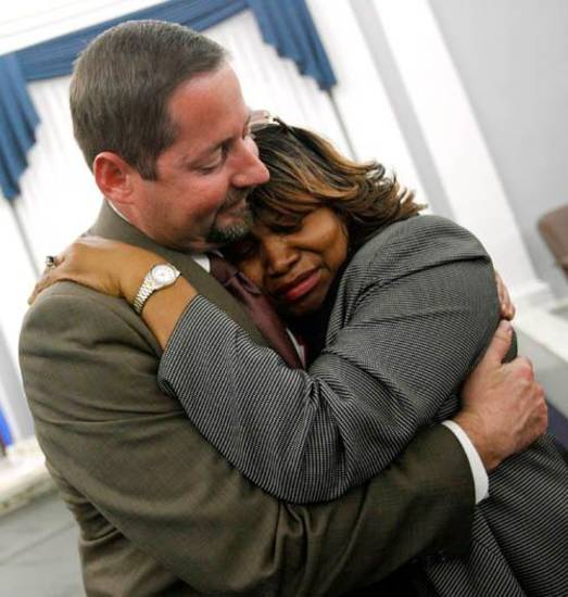 Ampora Shanor, the mother of murder victim Paul Shanor, hugs Stillwater Police Department detective sergeant Jeff Watts, the lead detective in Paul Shanor's murder case, after Korrus Harrison was found guilty of murder at the Payne County Courthouse in Stillwater, Okla., Wednesday, January 9, 2008. BY MATT STRASEN, THE OKLAHOMAN