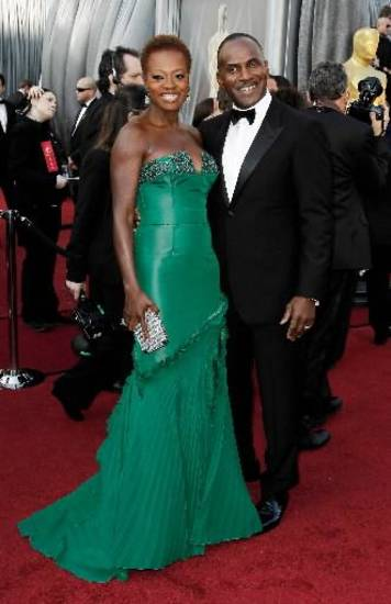 Viola Davis, left, and Julius Tennon arrive before the 84th Academy Awards on Sunday, Feb. 26, 2012, in the Hollywood section of Los Angeles. (AP)