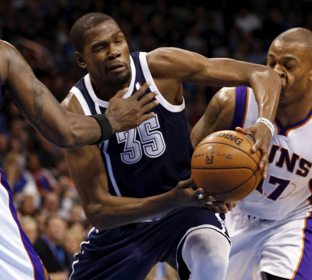OKC�s Kevin Durant, left, drives past Phoenix Suns� P.J. Tucker during the Thunder�s 114-96 win on Monday. Photo by Steve Sisney, The Oklahoman