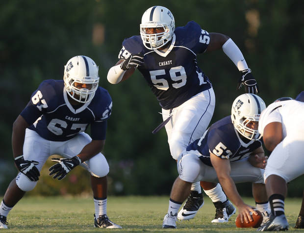 Casady's Josh Wariboko-Alali shifts positions before the snap against Holland Hall during their high school football game at Casady in Oklahoma City, Friday, August 30, 2013. Photo by Bryan Terry, The Oklahoman