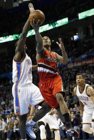 Portland Trail Blazers guard Damian Lillard (0) goes up for a shot.