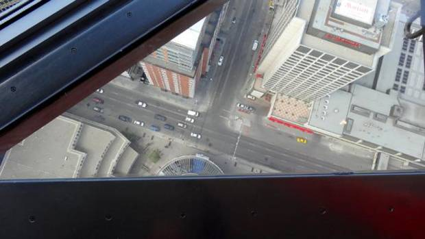 Peering downward through the glass floor of the Tower