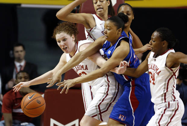 Oklahoma Sooner&#039;s Joanna McFarland (53) and Sharane Campbell (24) fight Kansas Jayhawks&#039; CeCe Harper (24) for the ball as the University of Oklahoma Sooners (OU) play the Kansas Jayhawks in NCAA, women&#039;s college basketball at The Lloyd Noble Center on Saturday, March 2, 2013  in Norman, Okla. Photo by Steve Sisney, The Oklahoman