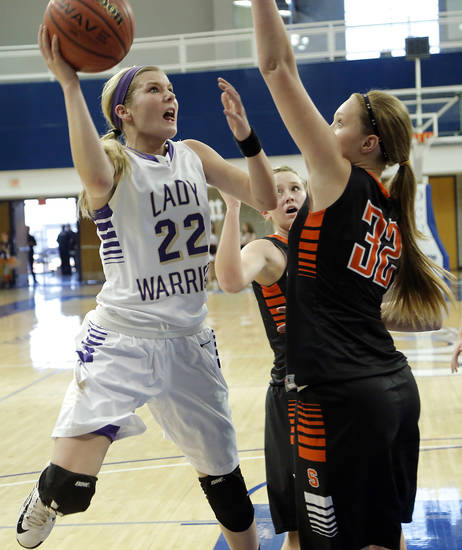 Okarche's Kenadey Grellner (22) shoots the ball over Sterling's Kelsee Milam (32) during the Class A girls state quarterfinal game between Okarche and Sterling at Oklahoma City University on Thursday, Feb. 28, 2013, in Oklahoma City, Okla. Photo by Chris Landsberger, The Oklahoman