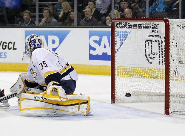 Nashville Predators goalie Pekka Rinne (35), of Finland, looks back as San Jose Sharks defenseman Dan Boyle scored a goal during the first period of an NHL hockey game in San Jose, Calif., Saturday, March 2, 2013. (AP Photo/Tony Avelar)