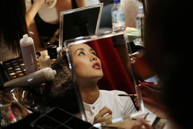 Model Naomi Obata prepares make-up before a show at the Tokyo Fashion Fuse event in Tokyo Saturday Aug. 20, 2011. The event is a merger of music and fashion featuring top models and international DJs. (AP Photo/Greg Baker)