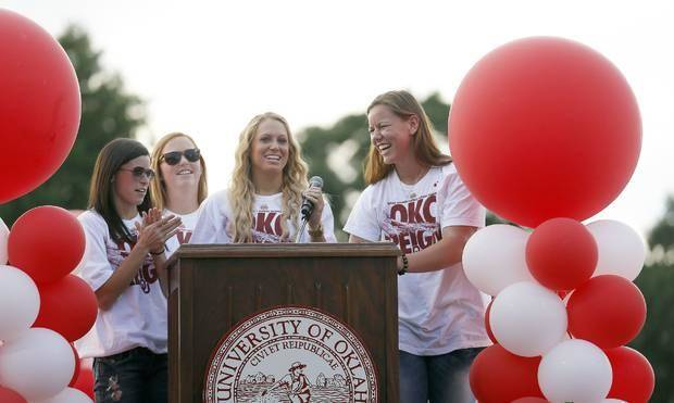 Oklahoma's Brianna Turang, left, Michelle Gascoigne, Jessica Shults and Keilani Ricketts, right, speak to the crowd during a celebration of their Women's College World Series title Friday. Photo by Sarah Phipps, The Oklahoman