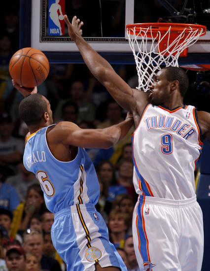 Oklahoma City's Serge Ibaka (9) defends Denver's Arron Afflalo (6) during the NBA basketball game between the Oklahoma City Thunder and the Denver Nuggets at Chesapeake Energy Arena in Oklahoma City, Wednesday, April 25, 2012. Photo by Bryan Terry, The Oklahoman