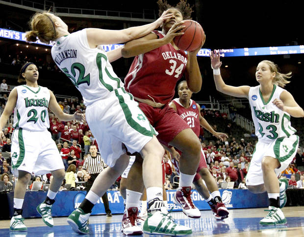 OU's Abi Olajuwon tries to get around Notre Dame's Erica Williamson as Ashley Barlow , left, and Melissa Lechlitner during the Sweet 16 round of the NCAA women's  basketball tournament in Kansas City, Mo., on Sunday, March 28, 2010. 