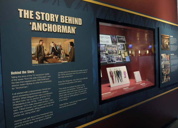 "Information about the ""Anchorman"" movie are seen at an exhibit at the Newseum in Washington, Friday, Nov. 15, 2013. The museum about news and the First Amendment has opened ""Anchorman: The Exhibit,"" featuring costumes and props from Will Ferrell's 2004 movie ""Anchorman: The Legend of Ron Burgundy."" The story of a fictional news team's sexist reaction to the arrival of an ambitious female reporter was a parody of real tumult in the 1970s TV business. (AP Photo/Susan Walsh)"