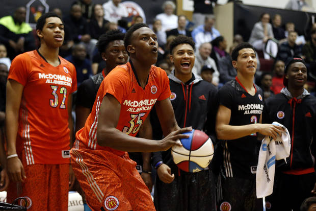 McDonald's East All-American Myles Turner, of Bedford, Texas, competes in the three-point shootout during the McDonald's All-American Jam Fest at the University of Chicago in Chicago, on Monday, March 31, 2014. (AP Photo/Andrew A. Nelles)