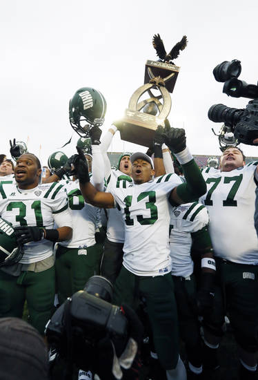 Ohio players celebrate their 45-14 win over Louisiana-Monroe in the Independence Bowl NCAA college football game in Shreveport, La., Friday, Dec. 28, 2012. (AP Photo/Rogelio V. Solis)