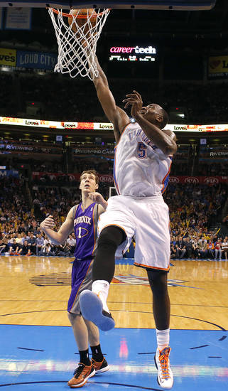 Oklahoma City's' Kendrick Perkins (5) shoots in from of Phoenix 's Goran Dragic (1) during the NBA game between the Oklahoma City Thunder and the Phoenix Suns at theChesapeake Energy Arena, Friday, Feb. 8, 2013.Photo by Sarah Phipps, The Oklahoman