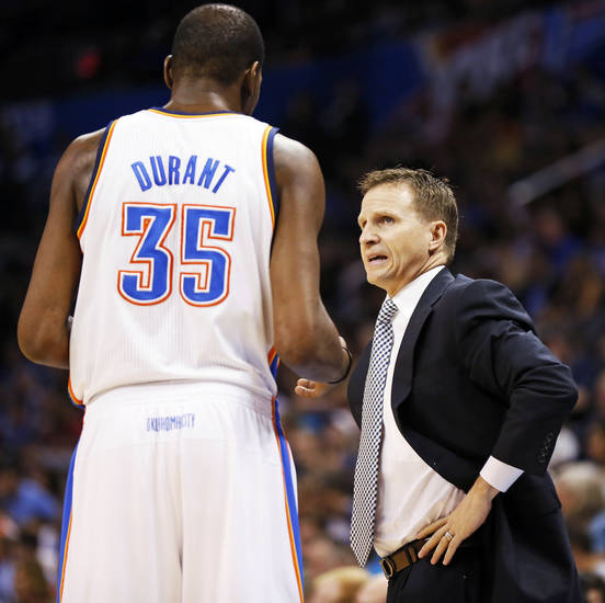 Oklahoma City head coach Scott Brooks, right, talks to Kevin Durant (35) during an NBA basketball game between the Oklahoma City Thunder and the Orlando Magic at Chesapeake Energy Arena in Oklahoma City, Friday, March 15, 2013. Photo by Nate Billings, The Oklahoman