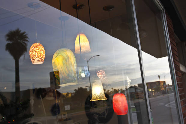 A local shop displays a variety of pendant lights on Roosevelt Street along the Roosevelt Row neighborhood Tuesday, Nov. 27, 2012, in Phoenix.  The neighborhood is home to First Friday Art Walk, a Phoenix tradition since 1994, promoting local artists and shops.(AP Photo/Ross D. Franklin)