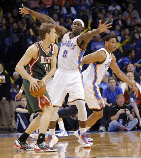 Oklahoma City�s Ronnie Brewer, right, defends Milwaukee �s Mike Dunleavy. Photo by Chris Landsberger, The Oklahoman
