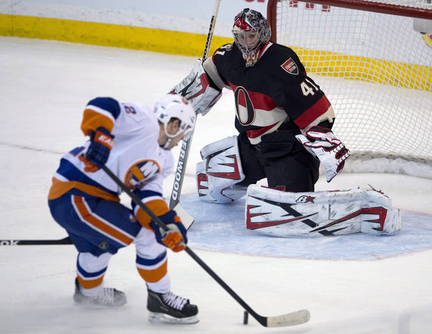New York Islanders center Josh Bailey shoots on Ottawa Senators goalie Craig Anderson during the first period of an NHL hockey game in Ottawa, Ontario, Tuesday, Feb. 19, 2013. (AP Photo/The Canadian Press, Adrian Wyld)