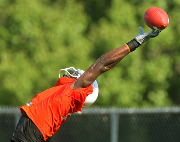 Wide receiver Dez Bryant tries to make a fingertip catch during the first Oklahoma State University fall football practice, in Stillwater, Okla., Thursday, July 31, 2008. BY MATT STRASEN, THE OKLAHOMAN