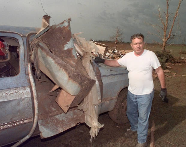 MAY 3, 1999 TORNADO: Tornado victims, damage: Henry Mobley, a Newcastle homeowner, the tornado hurled a hog feeder into his pickup truck.