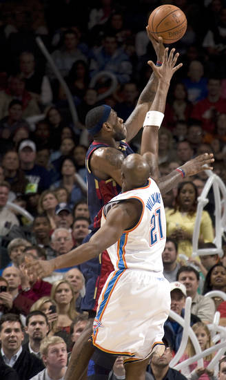 Cleveland's LeBron James shoots as Oklahoma City's Damien Wilkins (21) defends during the NBA game between the Oklahoma City Thunder and Cleveland Cavaliers, Sunday, Dec. 21, 2008, at the Ford Center in Oklahoma City. PHOTO BY SARAH PHIPPS, THE OKLAHOMAN
