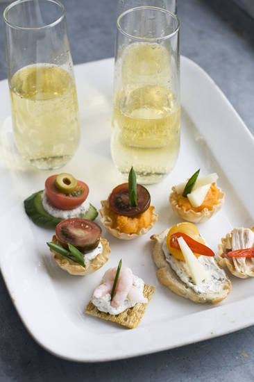 Using our building block approach to Oscar party canapes, diners are able to select from a buffet of ingredients � from bases and spreads to toppings and garnishes � to design snacks that suit their preferences as shown on this serving tray. AP Photo