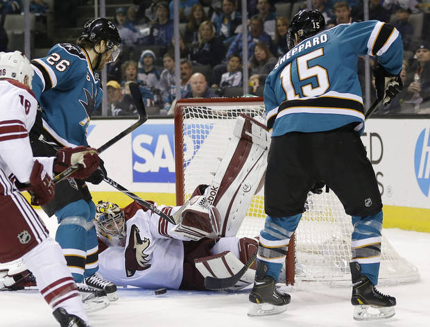 Phoenix Coyotes goalie Mike Smith, center, blocks a shot attempt from San Jose Sharks center Michal Handzus (26), of the Czech Republic,  as center James Sheppard (15) watches during the first period of an NHL hockey game in San Jose, Calif., Saturday, Feb. 9, 2013. (AP Photo/Marcio Jose Sanchez)