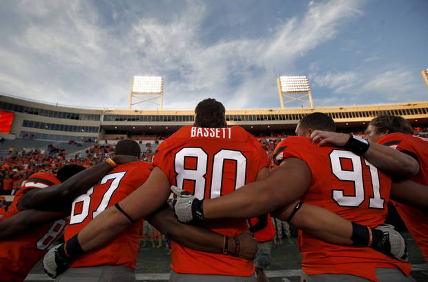 CELEBRATION: Oklahoma State's Tracy Moore (87), Cooper Bassett (80) and James Castleman (91) celebrate following a college football game between the Oklahoma State University Cowboys (OSU) and the Baylor University Bears (BU) at Boone Pickens Stadium in Stillwater, Okla., Saturday, Oct. 29, 2011. Photo by Sarah Phipps, The Oklahoman  ORG XMIT: KOD