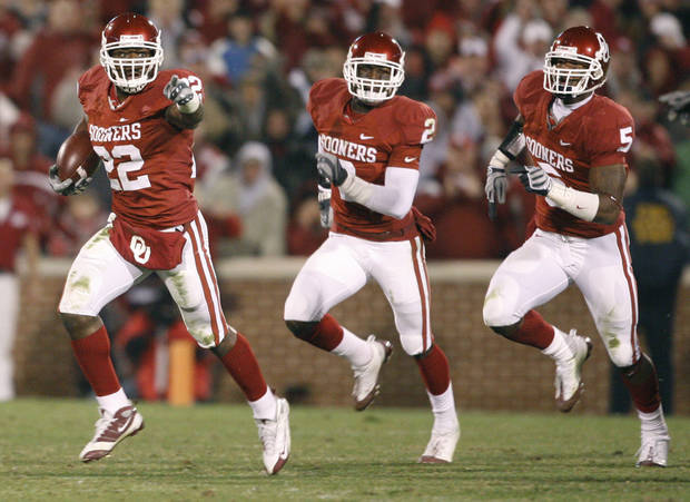 OU&#039;s Keenan Clayton, left, runs back a fumble followed by Brian Jackson, and Nic Harris during the college football game between the University of Oklahoma Sooners and Texas Tech University at Gaylord Family -- Oklahoma Memorial Stadium in Norman, Okla., Saturday, Nov. 22, 2008. BY BRYAN TERRY, THE OKLAHOMAN
